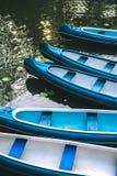 Canoe boats waiting for tourist hire on the lake in municipal city park. Hamburg.  Royalty Free Stock Photos