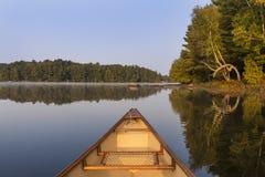 Canoe bow on a lake in late summer - Ontario, Canada. Canoe bow on a Canadian lake in late summer - Haliburton, Ontario stock photos
