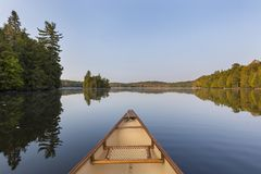 Canoe bow on a lake in late summer - Ontario, Canada. Canoe bow on a Canadian lake in late summer - Haliburton, Ontario royalty free stock photo