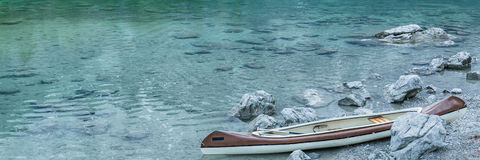 Canoe on calm blue lake, Aibsee, Germany Royalty Free Stock Photo