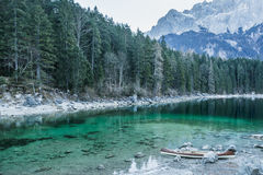 Canoe on calm blue lake, Aibsee, Germany Stock Images