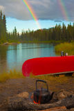 Canoe, Campfire and Rainbow Stock Images