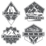 Canoe, camping and adventure vintage  grunge labels set Royalty Free Stock Images