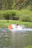 Canoe capsizing with people in it Stock Image