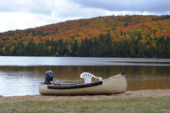 Canoe with chair and motor Stock Images