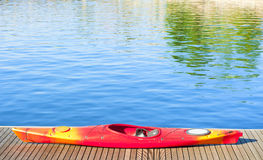 Canoe. Colorful canoe and blue water Royalty Free Stock Photos