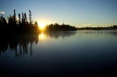 Canoe Country Lake. The sunrise over Homer Lake in the Boundary Waters Canoe Area of Minnesota, USA Stock Photos