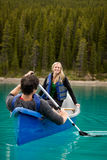Canoe Couple. A happy couple canoeing on a glacial lake royalty free stock photos