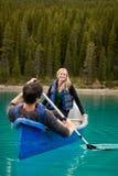 Canoe Couple. A happy couple canoeing on a glacial lake Royalty Free Stock Photos