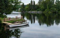Canoe in the cove Stock Photos