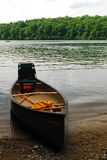 A canoe at the day`s end. A Canoe Rests at the end of the day on the banks of Walden Pond Royalty Free Stock Photo