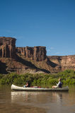 Canoe on desert river, mother and daughter Stock Image