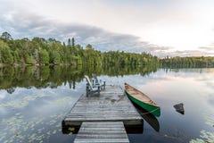 Canoe and Dock - Ontario, Canada. Canoe Tied to a Dock - Haliburton, Ontario, Canada royalty free stock images
