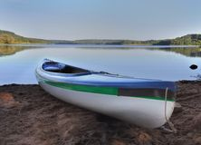 Canoe at the edge of a lake Stock Images