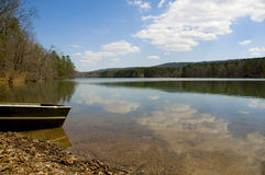 Canoe at edge of peaceful lake Royalty Free Stock Image