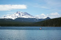 Canoe on Elk Lake in Mountains Stock Photo