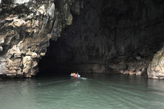 Canoe at the entrance of Tham Kong Lo cave. On Laos Royalty Free Stock Photo