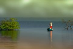 Canoe Fishing  Stock Images
