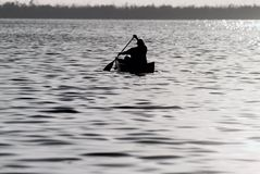 Canoe Fishing. Fisherman headed out on the canoe to fish Stock Image