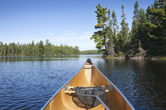Canoe with fishing net on northern Minnesota lake Royalty Free Stock Images