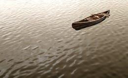 Canoe floating Stock Photography