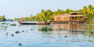 Canoe and houseboats in the Backwaters, Kerala, India Royalty Free Stock Photos