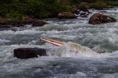 Canoe Jammed River Rapids. Canoe doubles jammed by water energy power in river rapids rocks Stock Photography