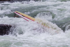 Canoe Jammed River Rapids. Canoe doubles jammed by water energy power in river rapids rocks Royalty Free Stock Photos