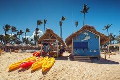 Canoe Kayak boats on sunny tropical beach with palm trees. Punta Cana Stock Image