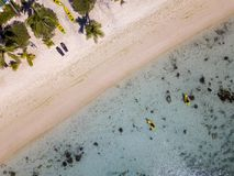 Canoe and kayaks in Polynesia Cook Island tropical paradise aerial view Royalty Free Stock Images