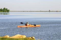 Canoe Lake. A photograph taken of a male paddling a canoe on the lake Stock Photos