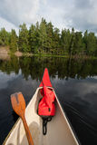 Canoe on a lake Stock Images