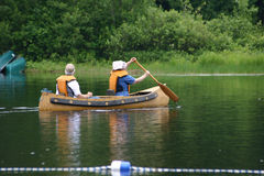 Canoe on the lake. A couple canoe on a private lake royalty free stock image