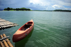 Canoe in the lake. Royalty Free Stock Photo