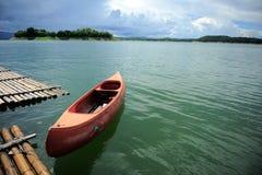 Canoe in the lake. Royalty Free Stock Photo