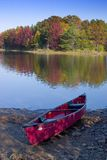 Canoe Lake Fall. A canoe rests on the shore of a lake in the fall stock photos