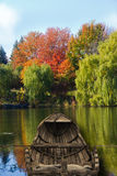 Canoe on lake during fall. Stock Image