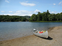 Canoe on lake in Northern Ontario. Aluminum canoe on a blue lake in the summer Royalty Free Stock Photography
