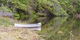 Canoe in a lake Royalty Free Stock Image