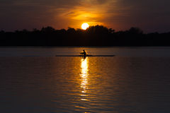 Canoe on lake at sunset Stock Photography