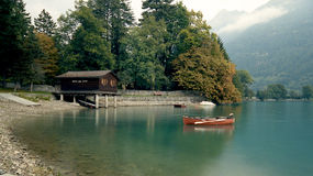 Canoe on lake in Swiss Alps Royalty Free Stock Images