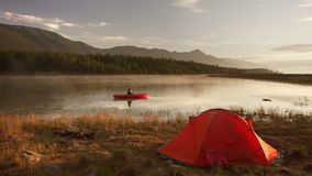 Canoe on the lake. Tourist canoeing on the Bay. Canoe on the lake. Tourist canoeing on the Bay near camping. 4k shot stock footage