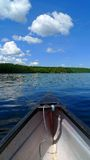 Canoe in lake. Canoe trip in lake with blue sky Royalty Free Stock Photography