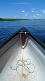 Canoe in lake. Canoe trip in lake with blue sky Royalty Free Stock Photos