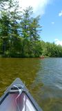 Canoe in lake. Canoe trip in lake with blue sky Royalty Free Stock Photo