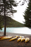 The canoe beside the lake. The yellow canoe beside the lake Royalty Free Stock Images