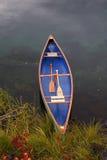Canoe on a lakeshore Stock Image