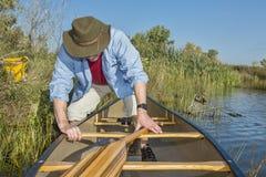 Canoe launching on a lake Stock Photo