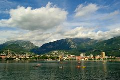 Canoe lesson on lake Como in summer in front of Lecco city. Stock Image