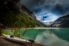 Canoe by the magnificent Lake Louis Stock Images